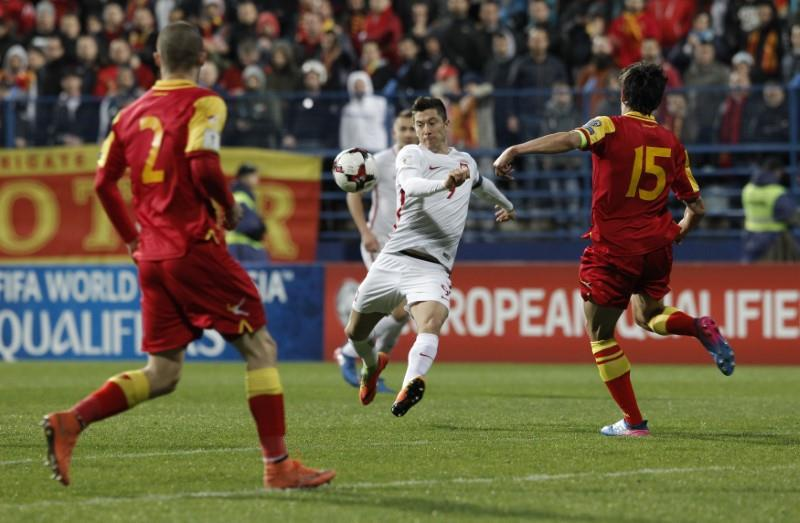 Poland surge clear at the top after 2-1 win in Montenegro - Football