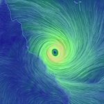 Cyclone Debbie 'to be worse than Yasi' as tourist dies in storm zone
