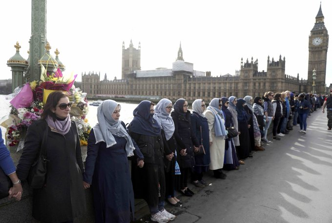 Muslim women link hands in solidarity on Westminster Bridge to remember the victims of the London attack, which left 4 people dead.