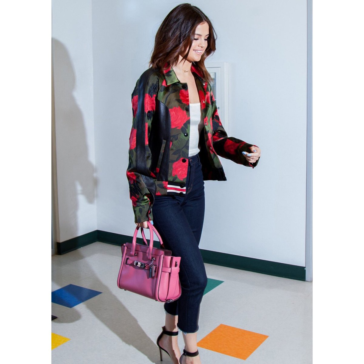#SelenaGomez in our #CoachSpring2017 Camo Rose Varsity Jacket and Swagger 27 Bag. #WhatsYourSwagger