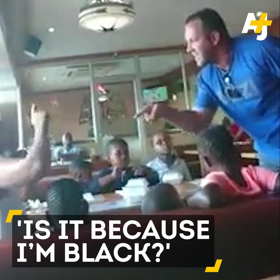 A white man in South Africa threatened to hit a black woman in front of children.