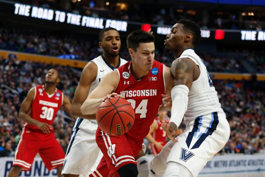 In first major NCAA upset, No. 8 Wisconsin tops reigning champs Villanova