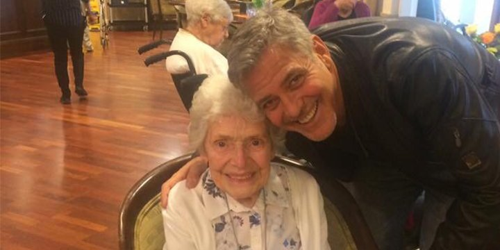 Awww! ? George Clooney pays a visit to an elderly fan in England on her birthday