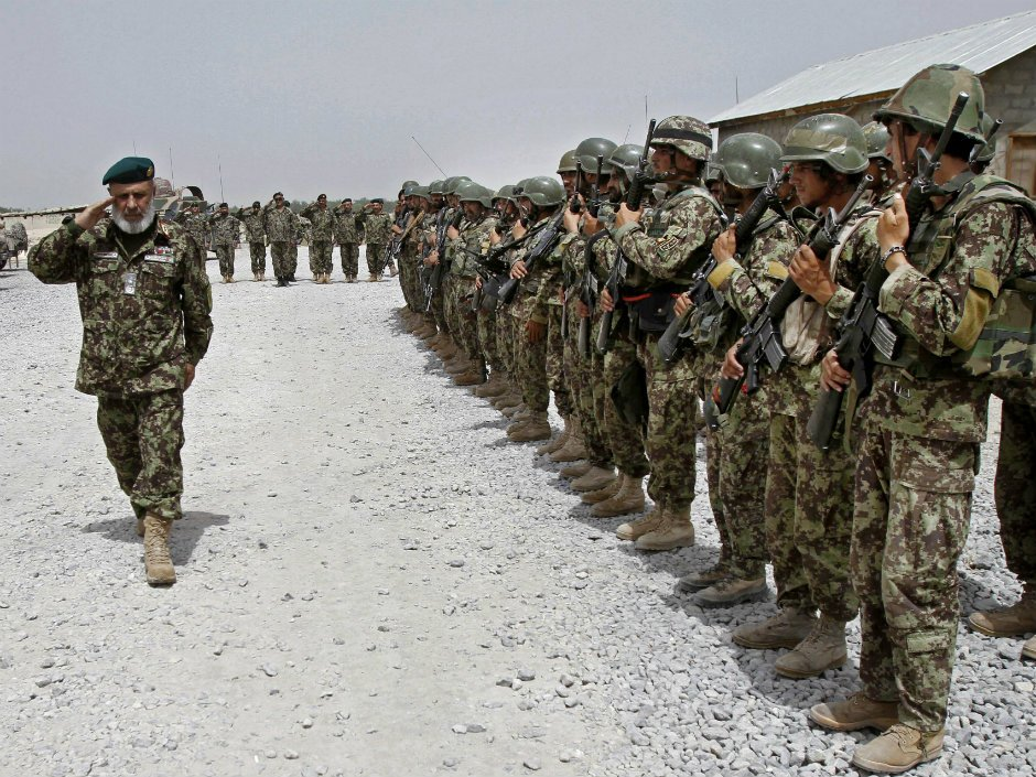 Taliban take key Afghan district in culmination of a deadly offensive that lasted