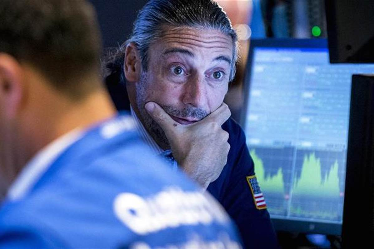 Dow falls 100 points ahead of contentious health care vote