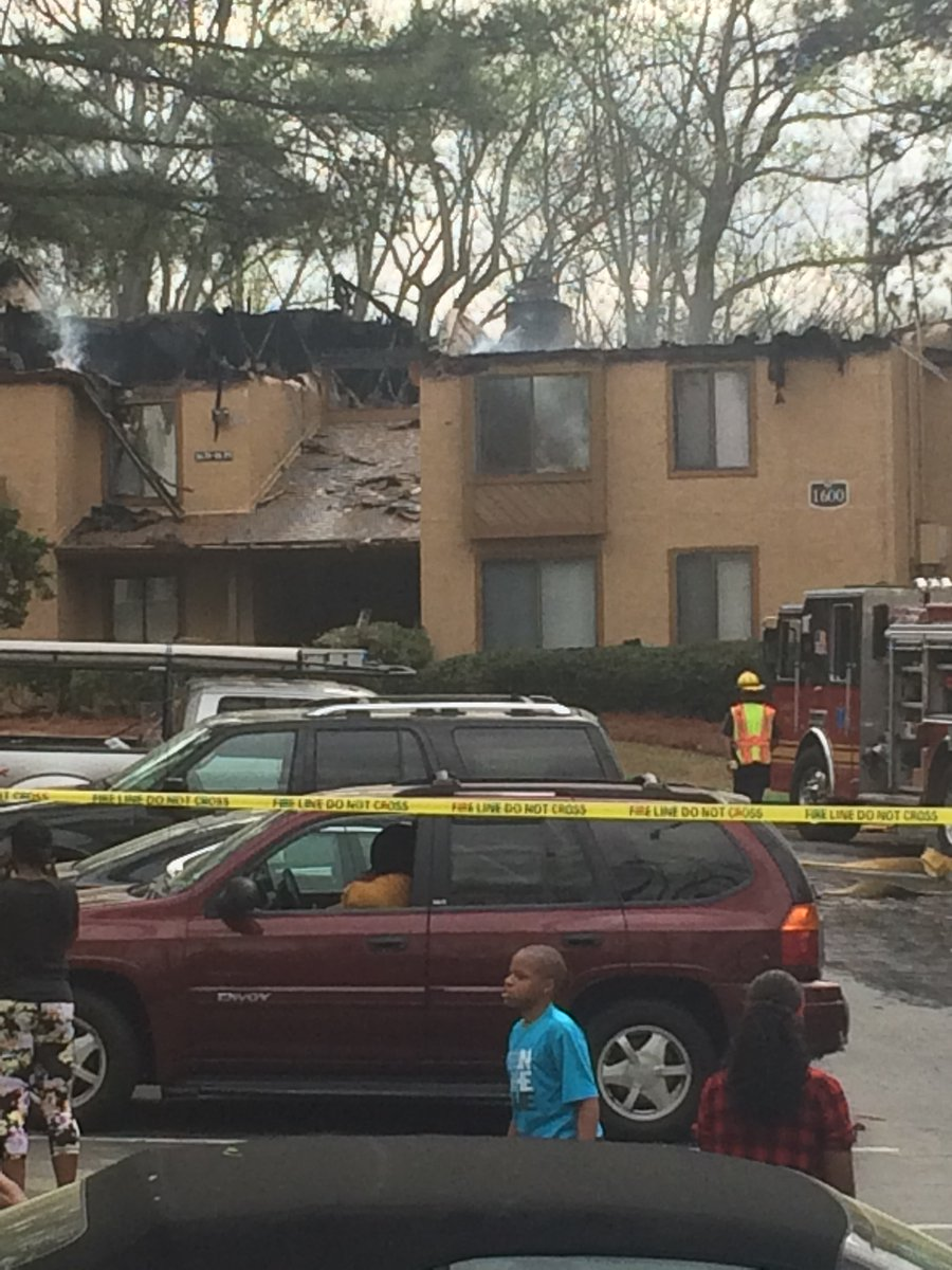 Flames burn the roof off of a Gwinnett County apartment building, destroying 10 units. No injuries. Cause unknown. Red Cross assisting.