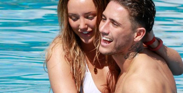 Bear licks Charlotte Crosby during amorous poolside display