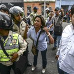 Venezuela seeks to cool protests as court reverses Congress annulment