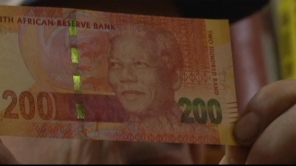 BUSINESS DAILY - South Africa's currency tumbles on credit rating cut