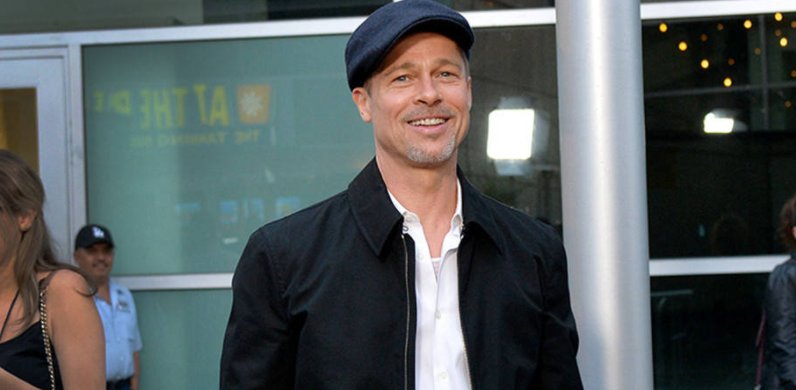 Brad Pitt has returned to the red carpet and he's all smiles.