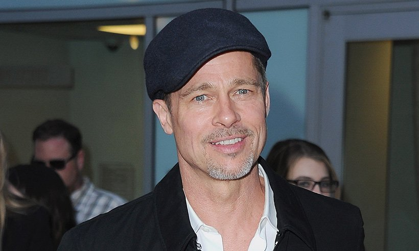 Brad's back! Brad Pitt has returned to the red carpet after a four month break: