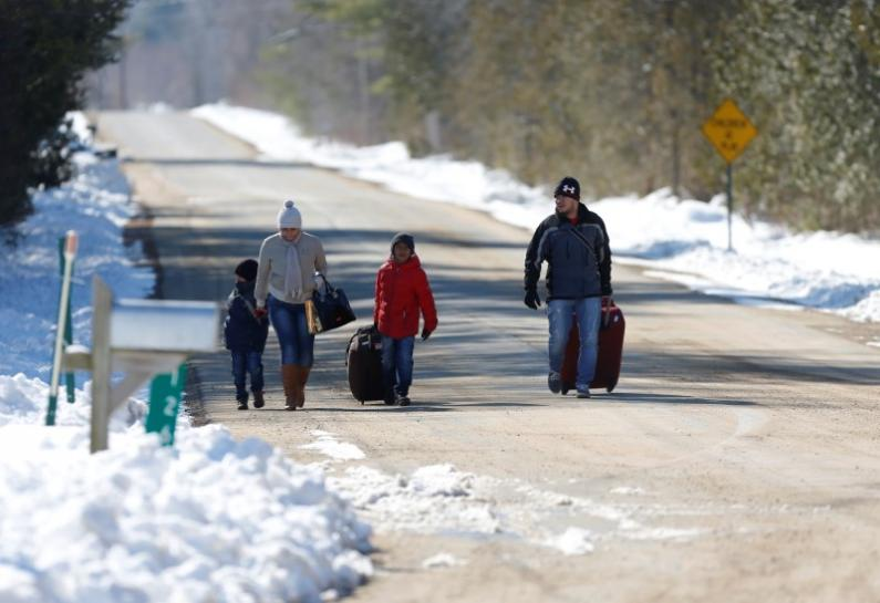 Asylum seekers crossing into Canada increase with warmer weather