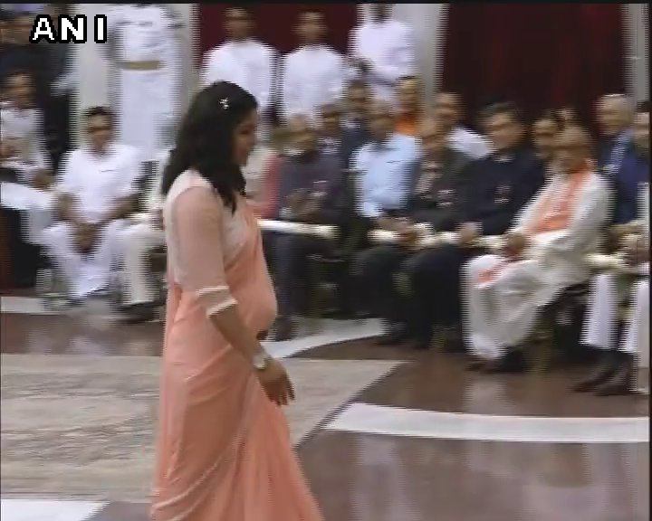 Wrestler Sakshi Malik receives Padma Shri from President Pranab Mukherjee in Delhi.