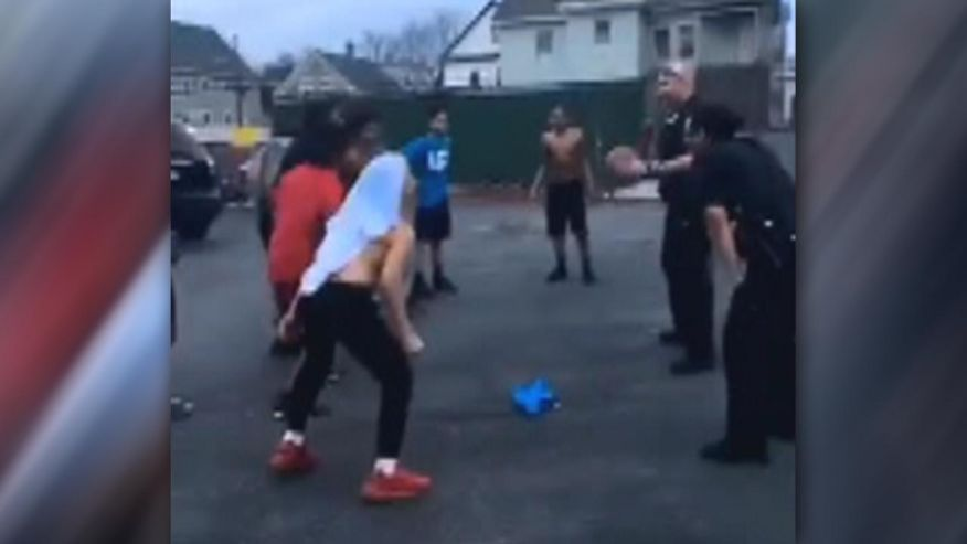 Massachusetts police praised for taking time to play basketball with kids