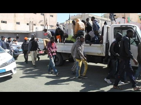 VIDEO -  Migrants targeted in Libya slave trade, UN reports