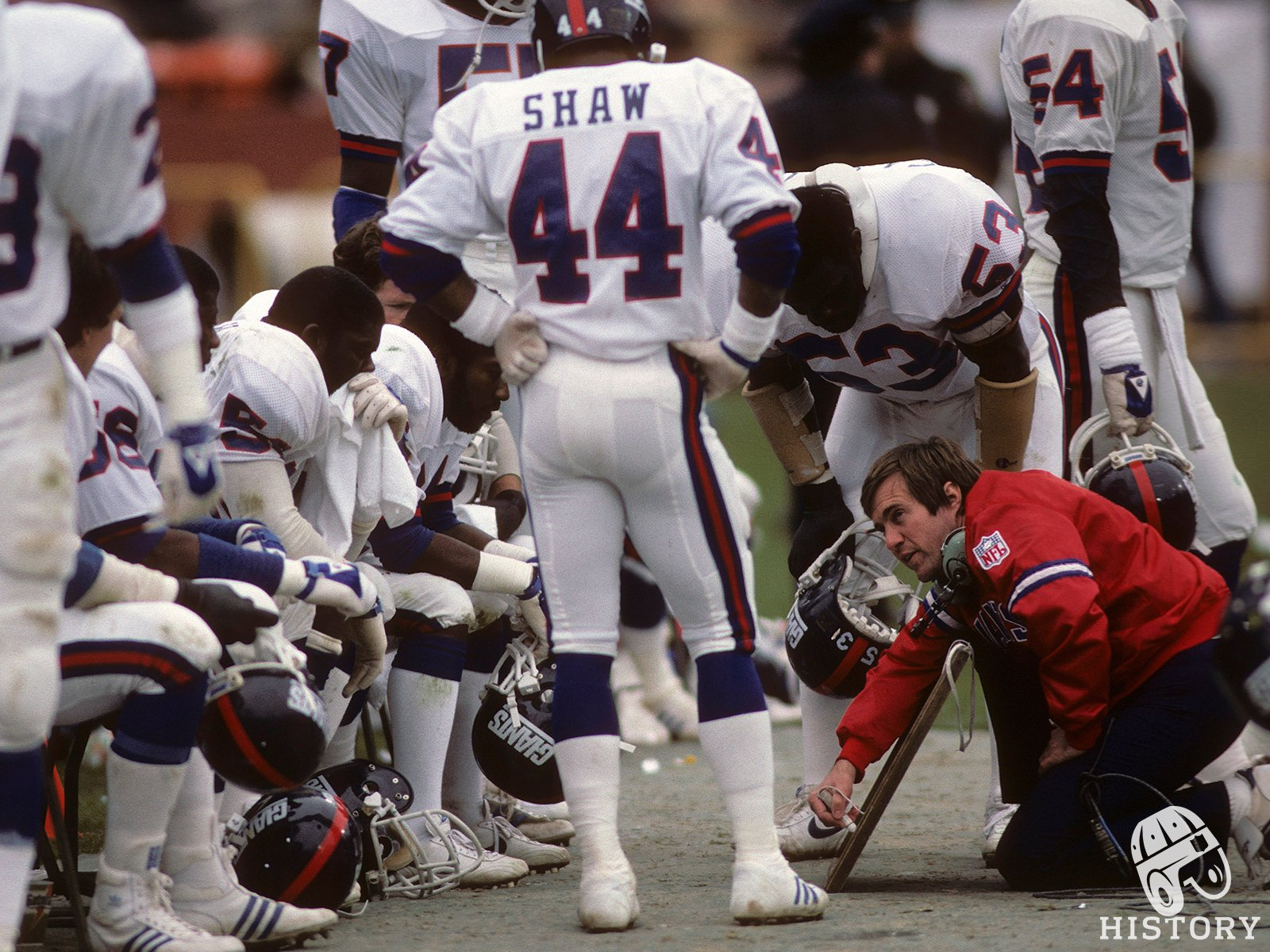 1984- HC Bill Belichick coaching up linebackers. Happy birthday Coach!