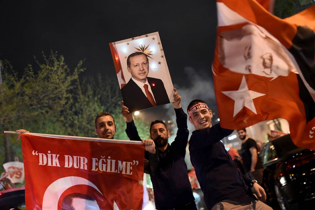 Turkish President Erdogan claims referendum win as critics cry fraud