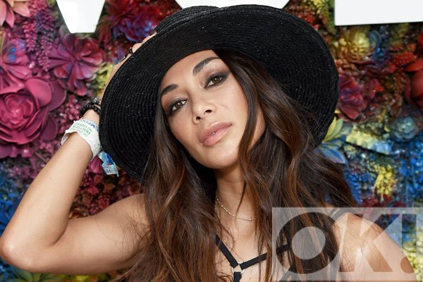 How amazing does X Factor judge @NicoleScherzy look at this year's Coachella?