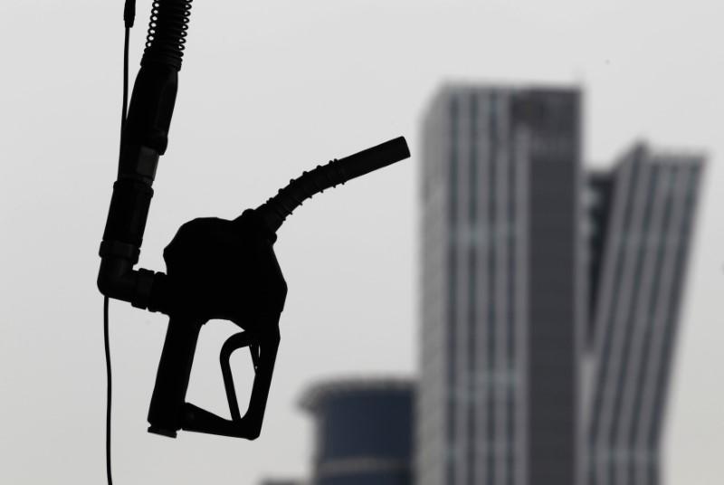 Oil slides as U.S. pumps more, but OPEC and North Korea loom