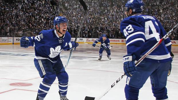 NHL playoff roundup: Leafs, Sens win in OT to take series lead; Flames almost extinguished