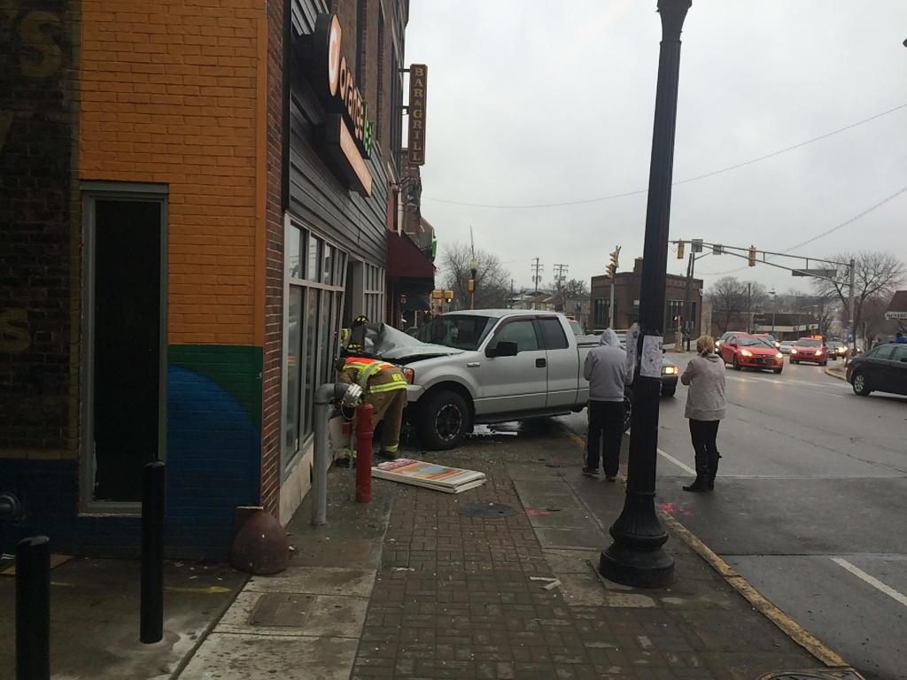 A truck has run into the @OrangeLeafWL building. Police say driver sneezed. Updates at http://t.co/cf4EceWCak. http://t.co/WMOeUqg5Ir