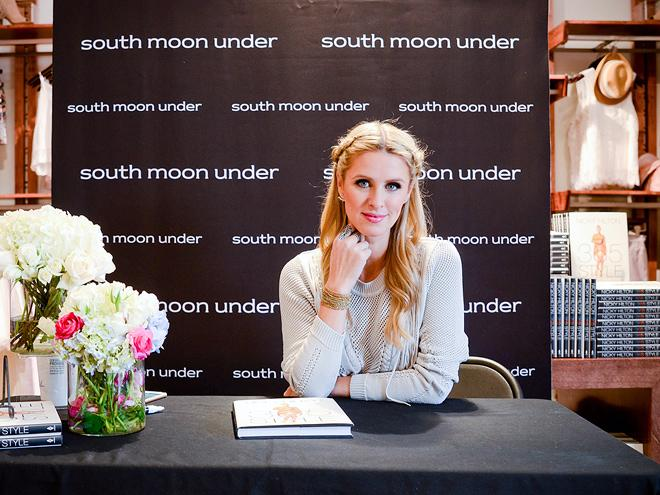 The beautiful #NickyHilton signs copy of her new book #365Style. #RUNWAY #celebrity #fashion http://t.co/4ac1VfT3kd