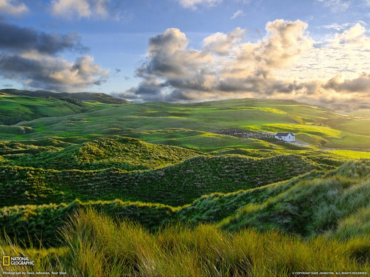 Morning sun touches the hills and sand dunes of Inishowen, Ireland