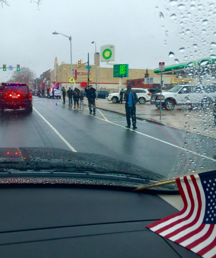Hundreds along the procession route stand in the rain to salute & honor P/O Wilson.  #RIPOfficerWilson #PhillyHero http://t.co/eumBsgn0Ss