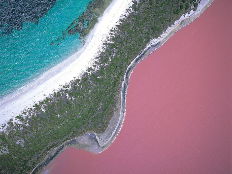 The real reason why Australia's Lake Hillier is colored a bilious, Pepto-Bismol shade of pink