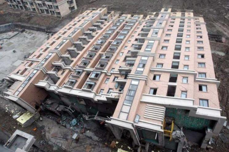 Entire New 13-Story Building Tips Over in Shanghai http://t.co/QqitZdIwe3 http://t.co/2rJOwsfLaE