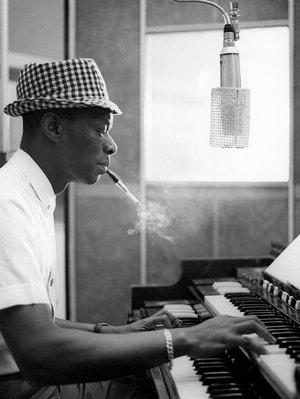 """It's Nat King Cole's birthday. From the archives, Robert Siegel on the """"incandescent"""" voice: http://t.co/E2eybhb9Xj http://t.co/NpGo0KBRIu"""