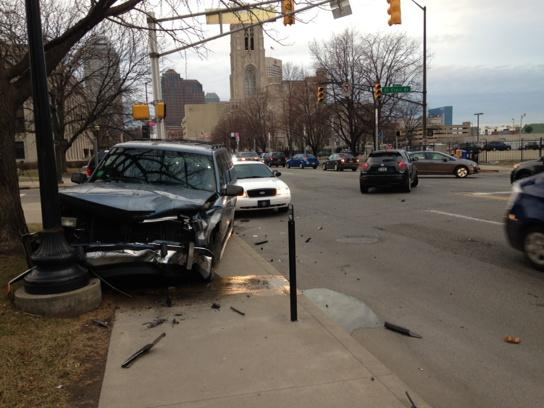 Avoid #Indy downtown! Manhole explosions. Power/traffic lights out. Crashes like this at Meridian/St Clair. http://t.co/3tcxlzerK9
