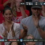 .@oliviamunn and @AaronRodgers12 cheer on Wisconsin, who trail UNC by 2 at the half on TBS #Sweet16 http://t.co/hiTHRvS7wW