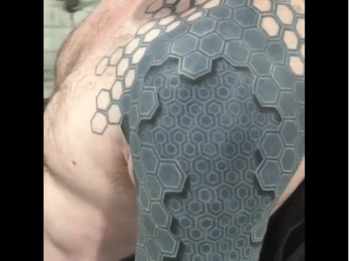 insanely detailed arm tattoo creates a 3d illusion