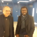 Coach Avram G. greets new Senegal coach before the start of the game. First match for Aliou Cisco in charge of Lions. http://t.co/DQ3ZVP0ZU3