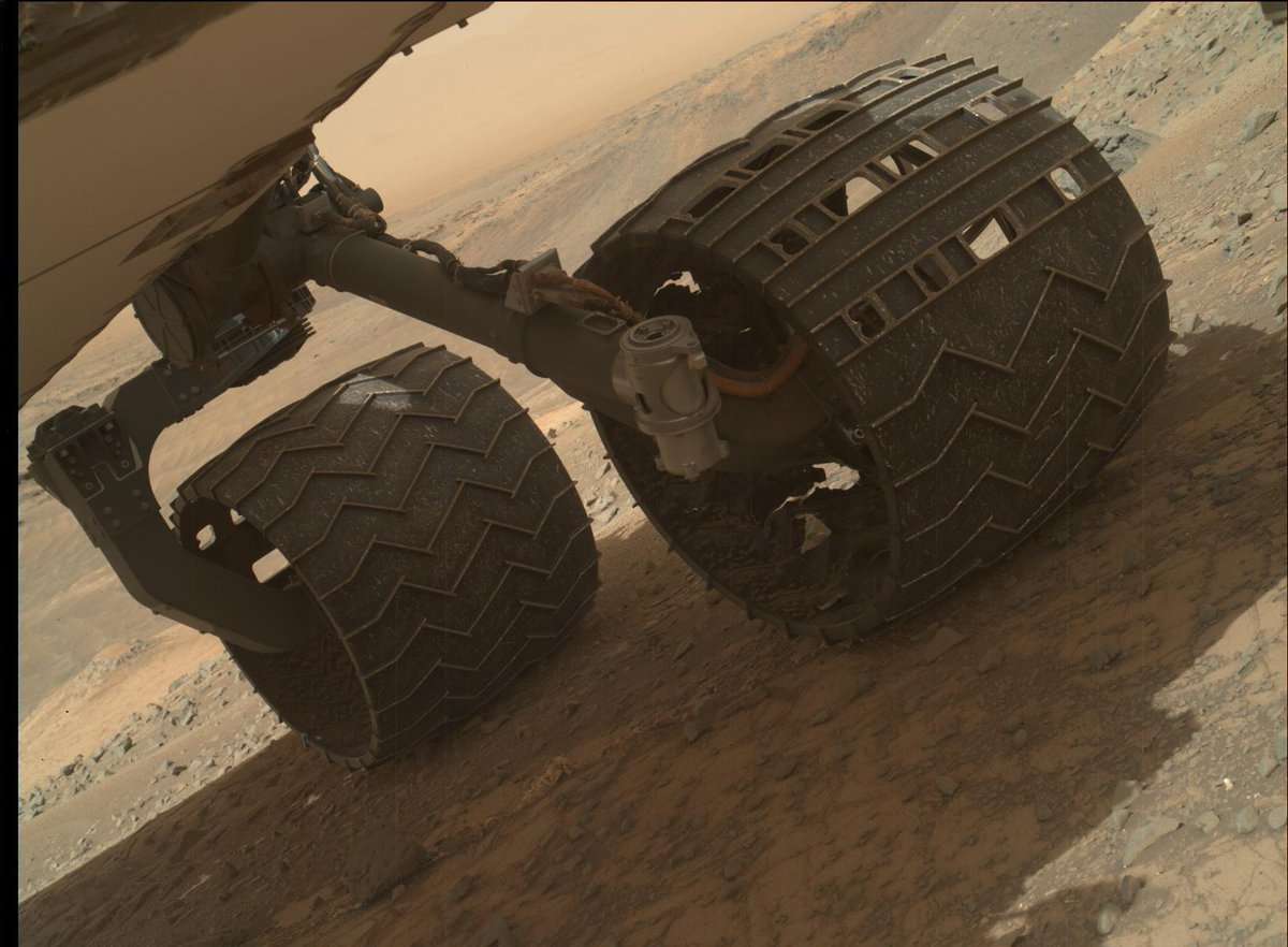Your daily dose of awe: Human-built wheels on an alien planet. Holes testify to miles traveled. Wheels still roll. http://t.co/Av0MpJejL6