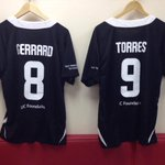 The #LFCAllStars shirts of Steven Gerrard and Fernando Torres inside the dressing room at Anfield. http://t.co/hv362L60Ry