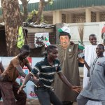 Happy voters dancing in front of @shehusani and @ThisIsBuhari dummy in Kaduna. #NigeriaDecides #SitRoom15 @omojuwa http://t.co/brsJgd9SwN