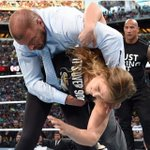 The moment when @TheRock knows @TripleH is in trouble! @RondaRousey #WrestleMania http://t.co/R7NwW6mX88