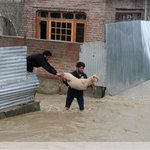 At least 10 people were buried by mudslides after heavy rain triggered flooding in Indian Kashmir #photo @roufbhat06 http://t.co/cJGL9DhfPF