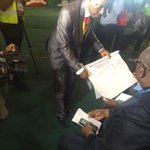 Result sheets been shown to party agents #NigeriaDecides http://t.co/ldGxjw7be0
