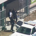 #UPDATE Female led away in handcuffs from Killian HS where student was stabbed this morning http://t.co/OsFAoe4v5A http://t.co/EcHJc2hlUj