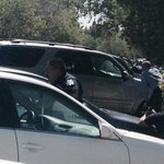 #BREAKING Officers taking cover behind cars. Our crew is also. SWAT is on scene. http://t.co/HAOXt1XJng