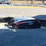 """""""@CP24: IN PHOTOS: Car falls into sinkhole in west-end parking lot http://t.co/5ncrKqcRXN http://t.co/2l9Di2GwKG"""" @gurtajboparai amrits next"""