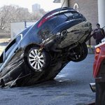 Sinkhole swallows car in Toronto; driver escapes unhurt http://t.co/UNrSVYeVEZ http://t.co/rvx3r7qubU