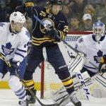 Sabre Mikhail Girgorenko tips a shot infront of Toronto Maple Leaf goaltender Jonathan Bernier. @BNHarrington http://t.co/J5q0E6NZya