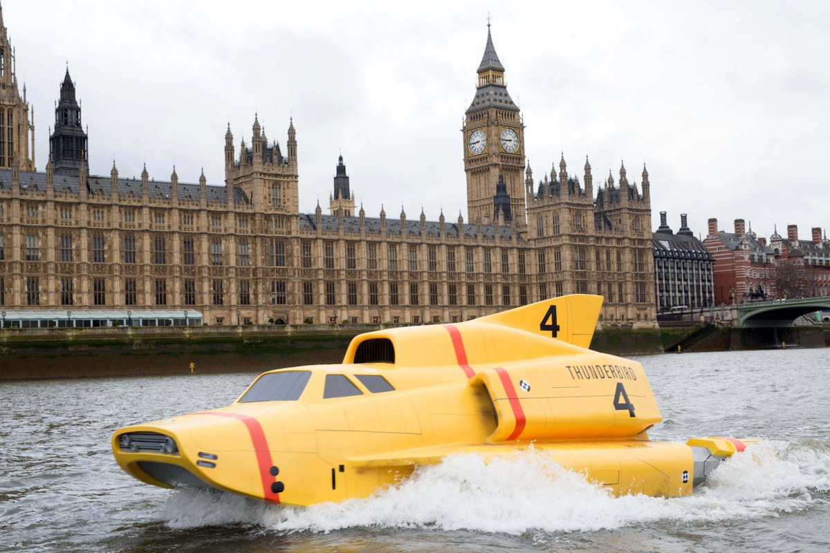 ... these photos of a 15-foot replica of Thunderbird 4 cruising down the Thames are pretty cool. #ThunderbirdsAreGo http://t.co/qzJLsV6Qfl