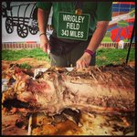 Tailgaters slice up a whole rotisserie hog outside of Principal Park before the @IowaCubs home opener in Des Moines. http://t.co/IgwyzbJdqQ