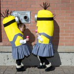 A pair of minion twins enjoy themselves before joining in the @calgaryexpo #ParadeofWonders. #yyc @downtowncalgary http://t.co/YzBHVFIBAb
