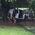 Authorities removing large bouquets of flowers from crashed van. #shjsc @GoUpstate http://t.co/3mnKZp2M4c